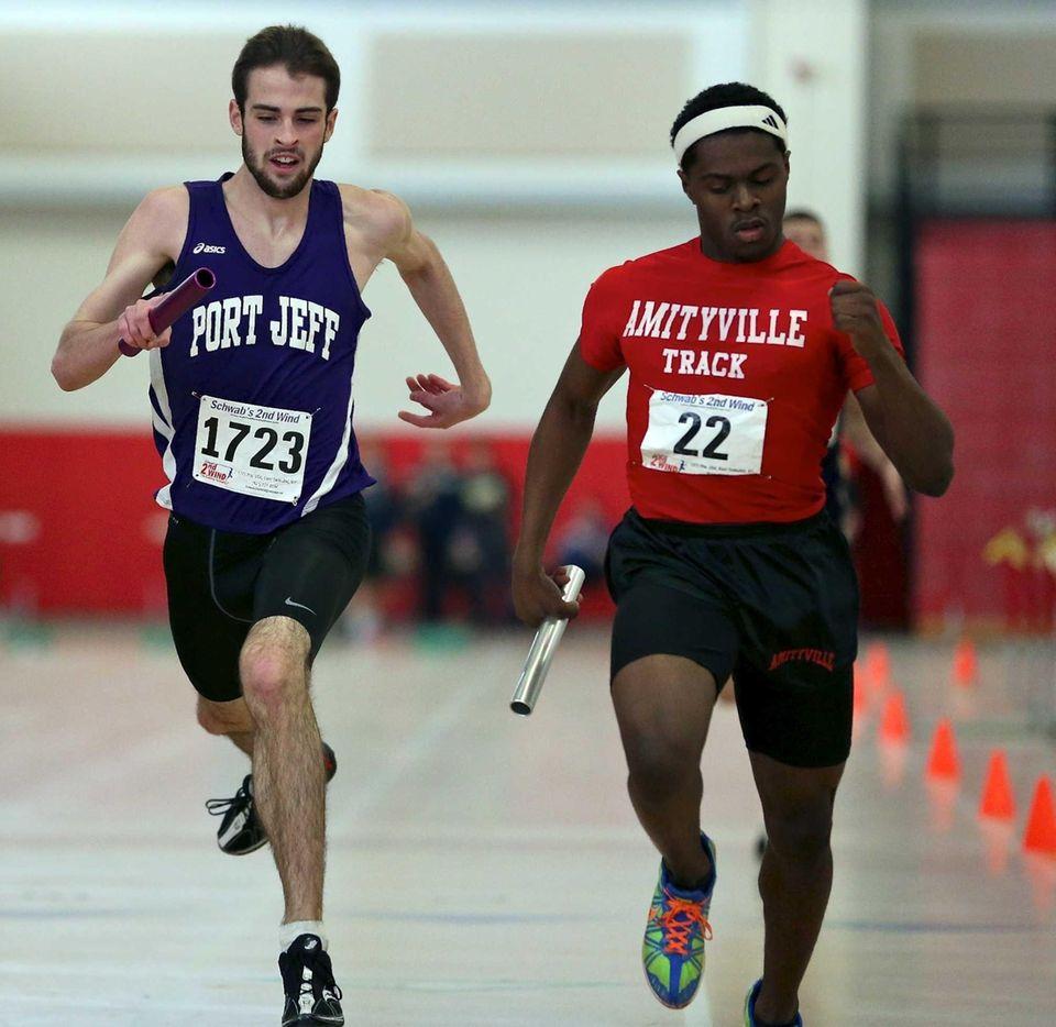 Amityville's Artneil Reid, right, wins a close race