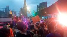 Demonstrators gather outside of the Barclays Center in