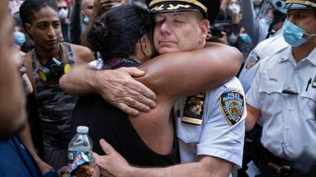 NYPD Chief of Department Terence Monahan hugs a