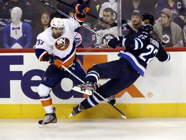 Islanders' Brian Strait checks Winnipeg Jets' Chris Thorburn