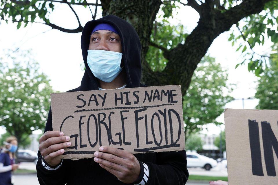 Peaceful demonstrators seeking justice for George Floyd who