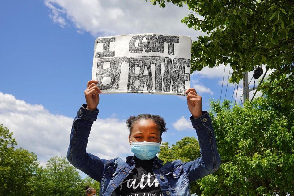 Stori Julien, 11, of Greenlawn joins a peaceful
