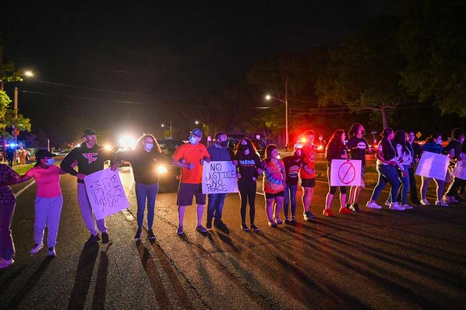 Protesters block the William Floyd Parkway in Shirley