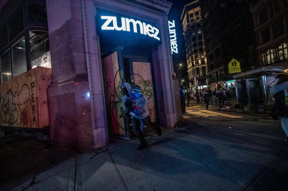 People run out of stores on Broadway with