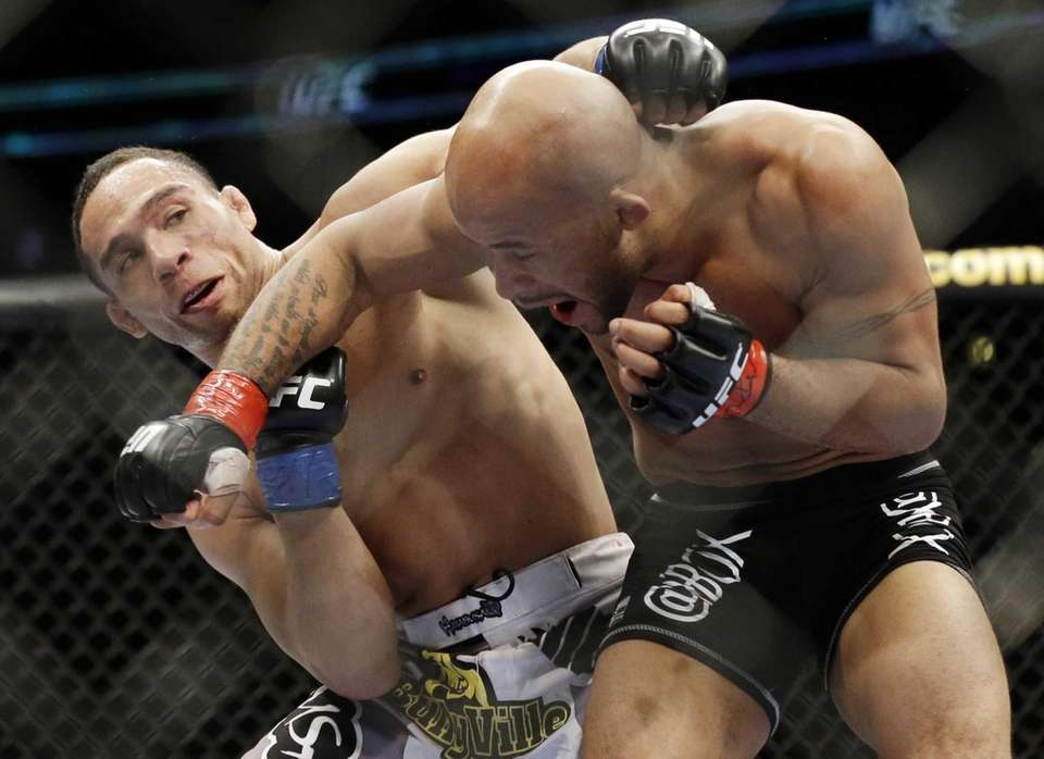 John Dodson, left, fights Demetrious Johnson during the