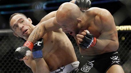 John Dodson, left, fights Demetrious Johnson during the