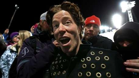 Shaun White leaves the venue after winning the