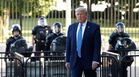 President Donald Trump walks in Lafayette Park to