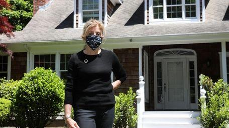 Lynn Sabatelle, of Daniel Gale Sotheby's International, outside