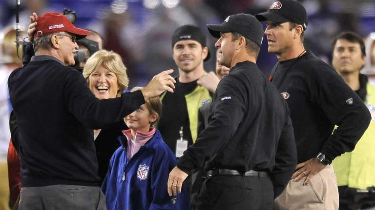 Jack Harbaugh, far left, and his wife Jackie,