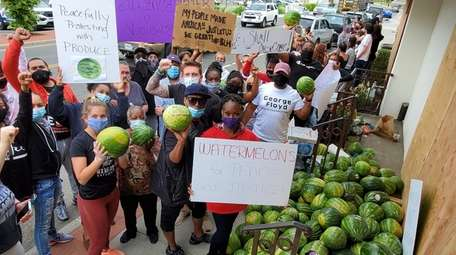 Demonstrators gather Tuesday at the Tutto Pazzo in