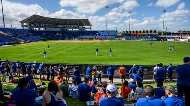 Mets fans look on during a spring training