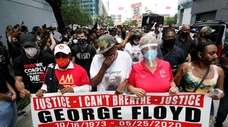 LaTonya Floyd, third from left, participates in a