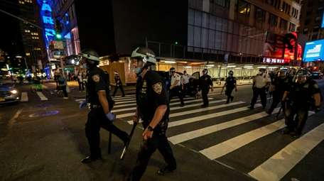 Police patrol the streets of Manhattan to discourage