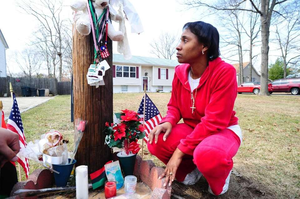Erica Boynton visits a memorial that marks the