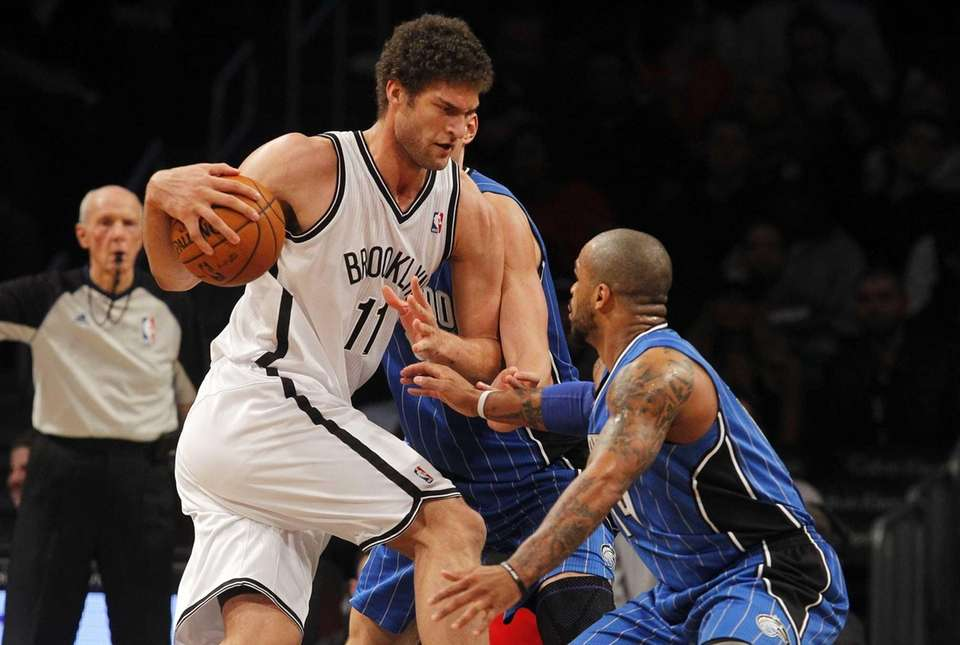 Brook Lopez drives against Jameer Nelson of the