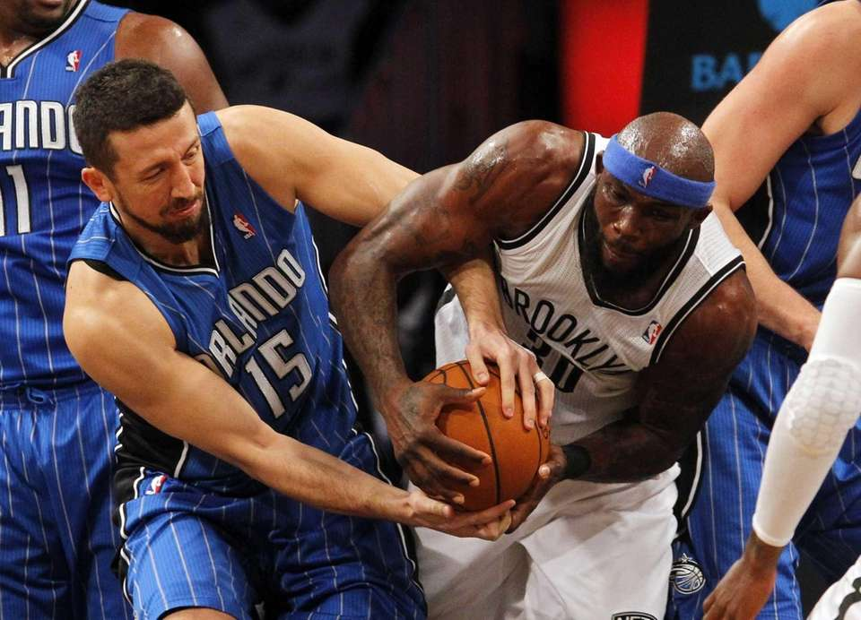 Reggie Evans Nets battles for a loose ball