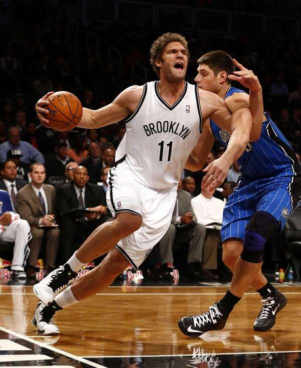 Brook Lopez of the Nets drives to the