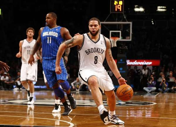 Deron Williams of the Nets controls the ball