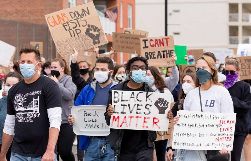 Protestors demonstrate on the Long Beach Boardwalk Tuesday,