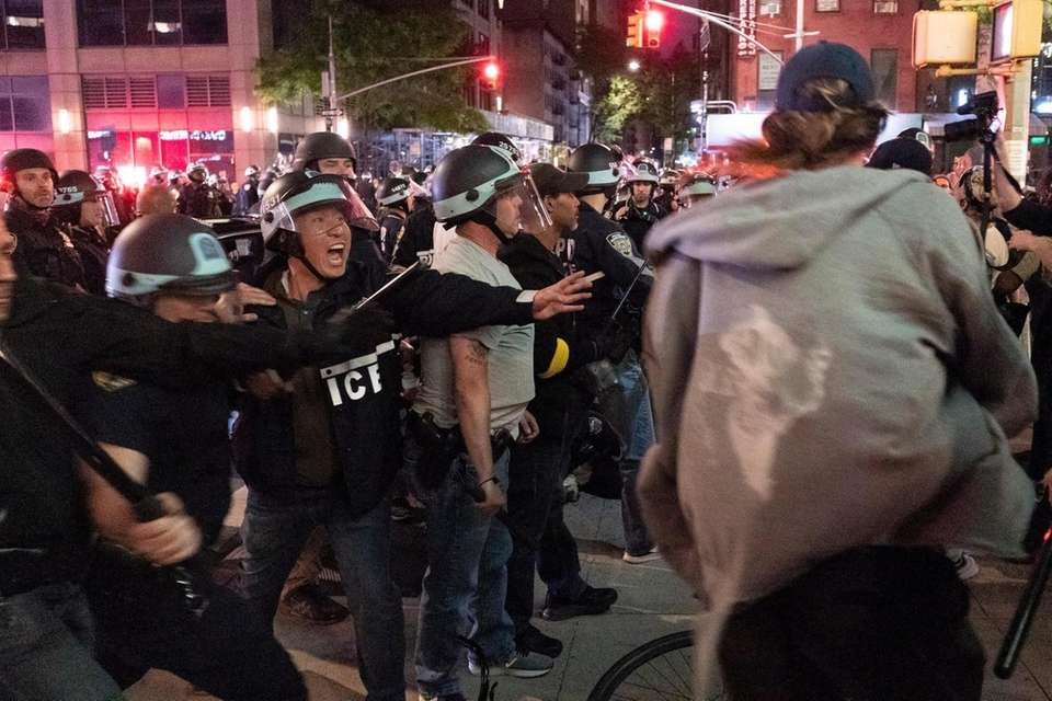 Members of the NYPD detain demonstrators against police