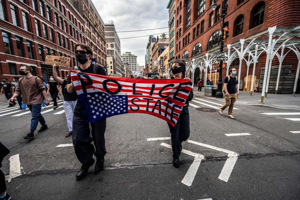 Late night protesters march in downtown Manhattan as