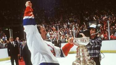 The Islanders' Bryan Trottier with the Stanley Cup