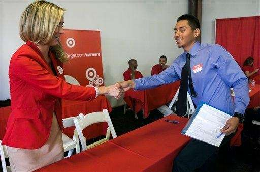 Target Senior Merchandiser, Lauren Glasenapp, left, welcomes prospective