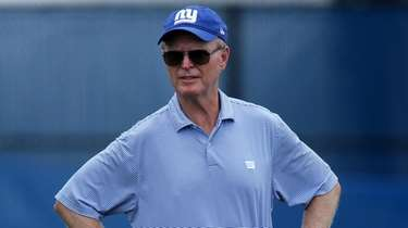 Giants president and CEO John Mara watches training