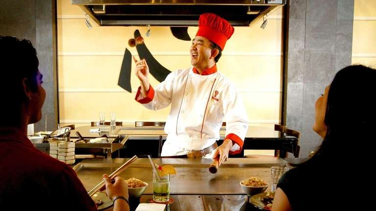 A hibachi chef shows his skills at Benihana