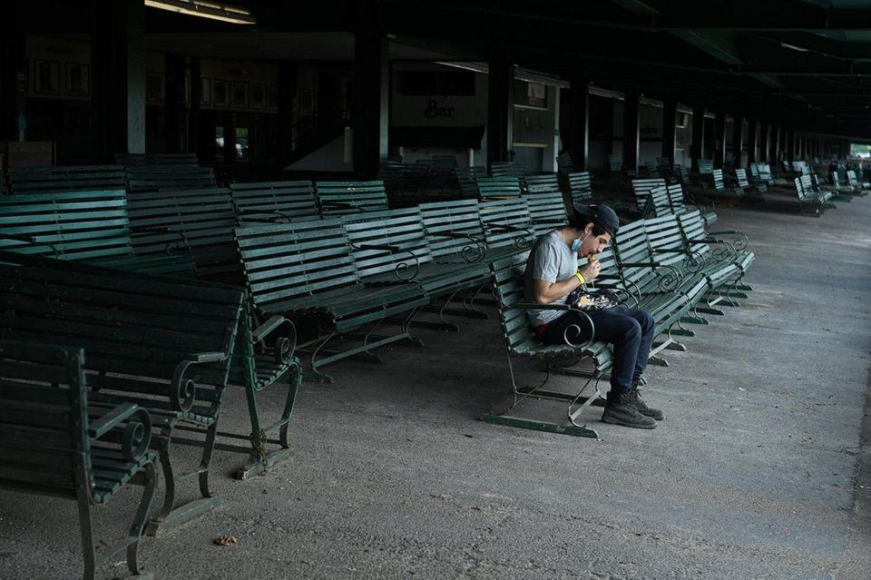 Cameraman Bryan Vasquez, eats his lunch in an