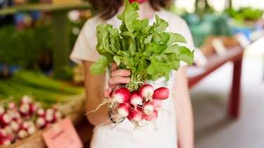 Radishes at the weekly farmers market at Restoration