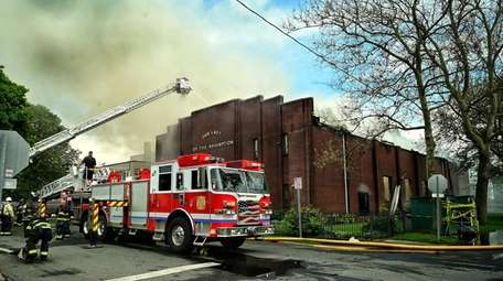 Firefighters from area departments battle a blaze at