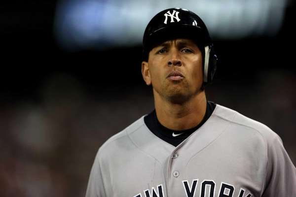 Alex Rodriguez of the Yankees walks off the