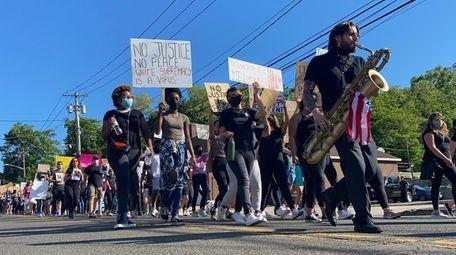 Demonstrators rally down New York Avenue on Wednesday