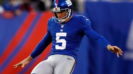 Steve Weatherford of the Giants punts against the
