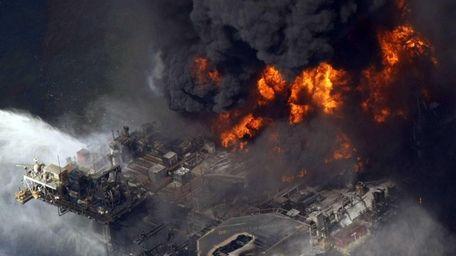 The Deepwater Horizon oil rig is seen burning.