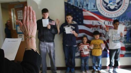 Children participate in a U.S. citizenship ceremony at