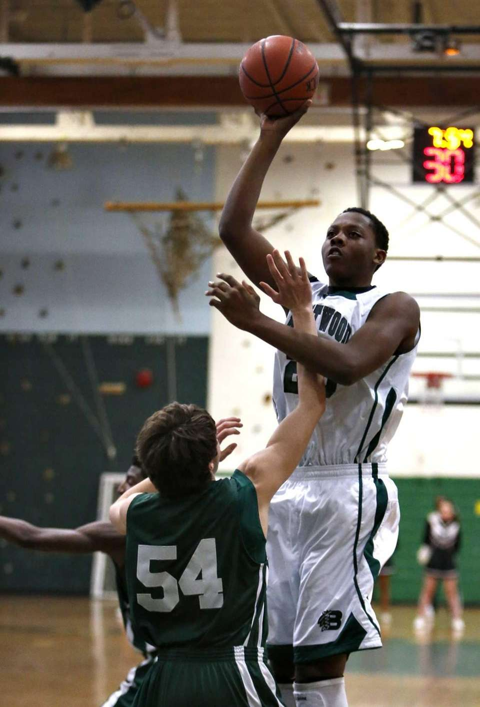 Brentwood's Olufami Otujobi goes high over Floyd's Brian
