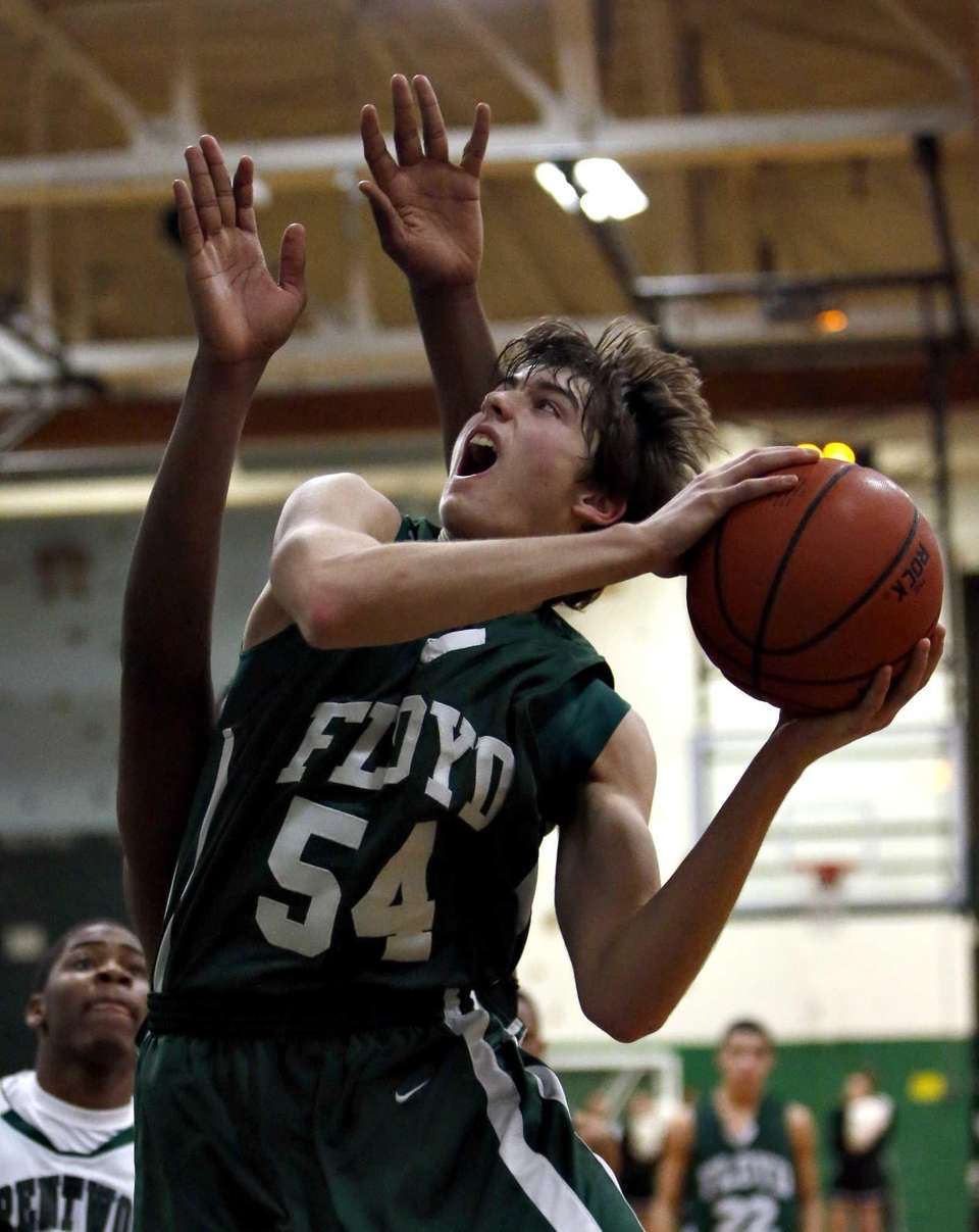 Floyd's Brian Samuelson drives to the hoop in