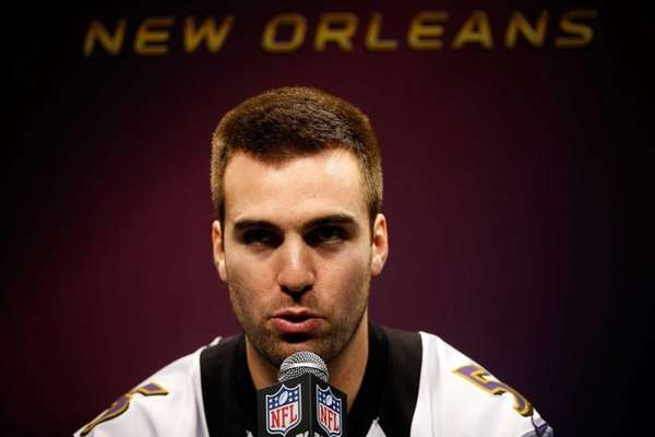 Baltimore Ravens quarterback Joe Flacco answers questions from