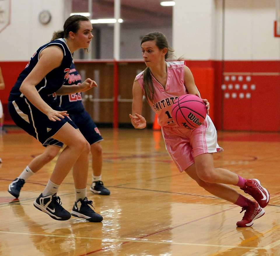 Smithtown East's Michele Scannell drives the outside against