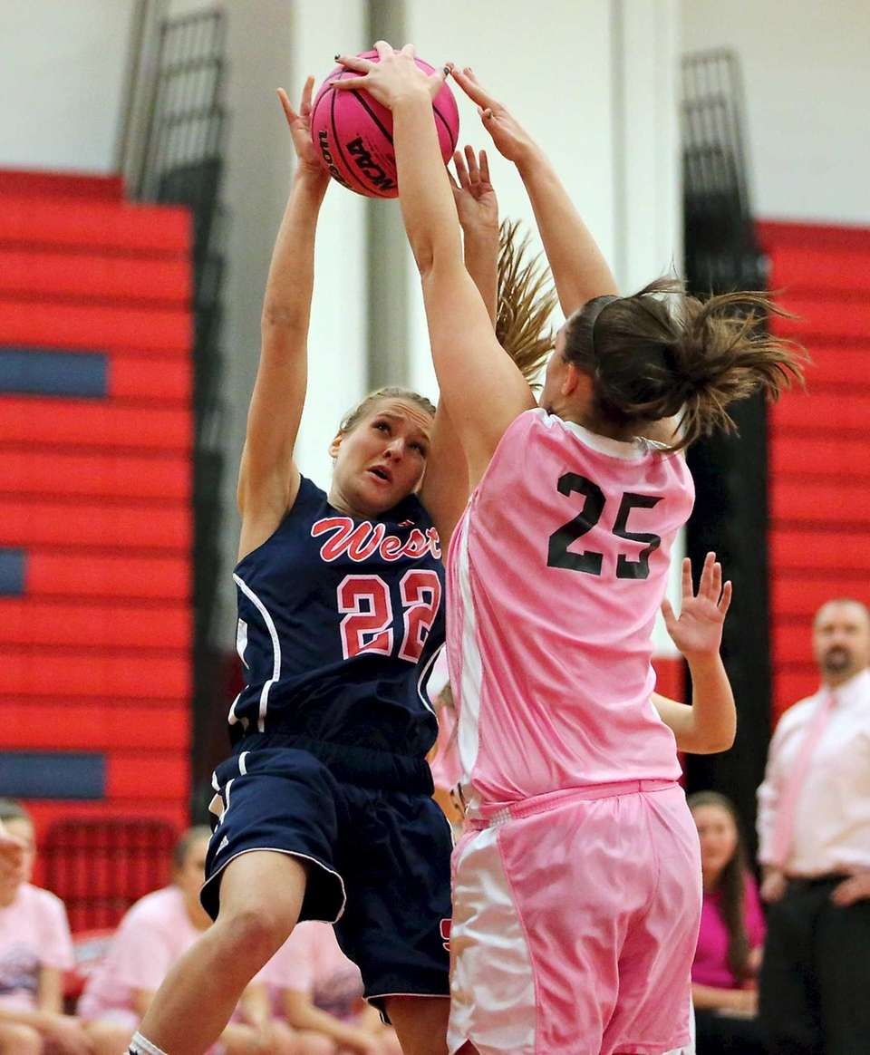 Smithtown East's Jessica Anderson blocks the shot of