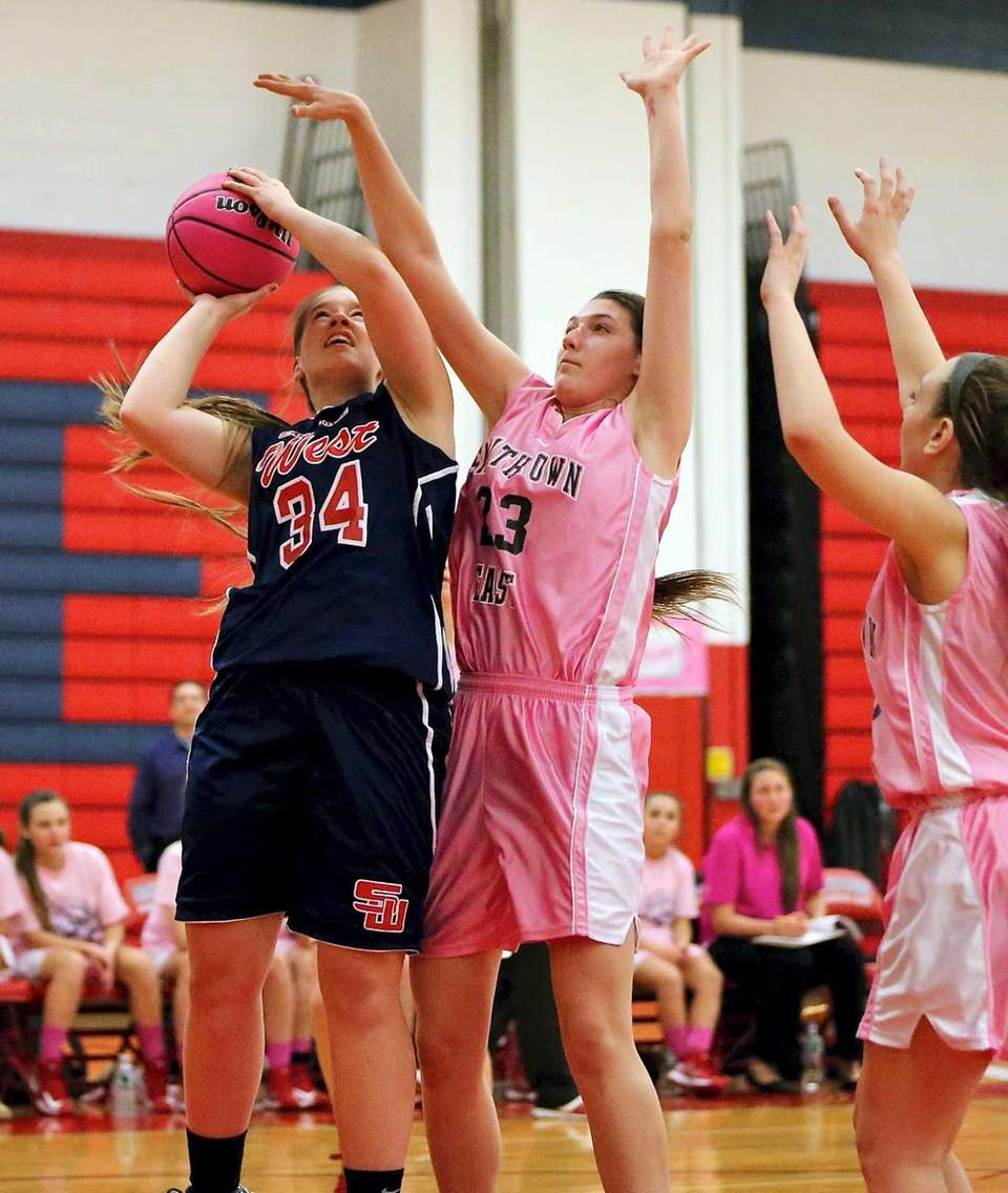 Smithtown West's Melissa Meyers puts the shot up