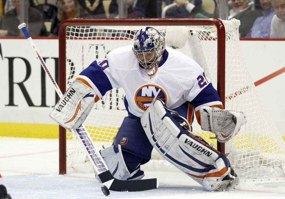 Evgeni Nabokov makes a save during a game