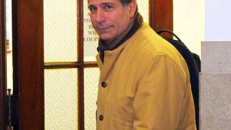 Long Beach City Councilman Michael Fagen leaves the