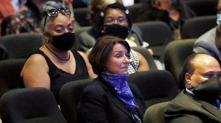 Sen. Amy Klobuchar, D-Minn., center sits among guests