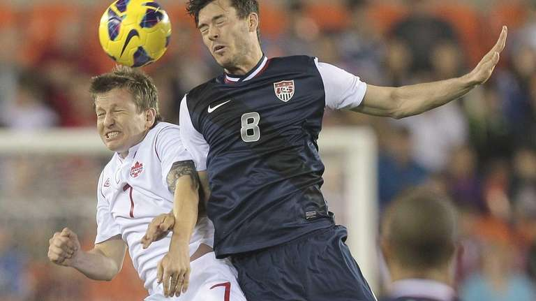 Brad Evans #8 of the U.S. goes up