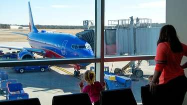 A Southwest plane prepares for departure at Long