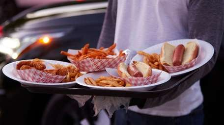 Hot dogs, fries and chicken strips are on